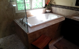 New Bathroom Design with Tub and Pebble Floor